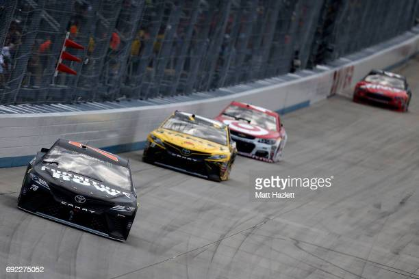 Martin Truex Jr driver of the Furniture Row/Denver Mattress Toyota leads a pack of cars during the Monster Energy NASCAR Cup Series AAA 400 Drive for...