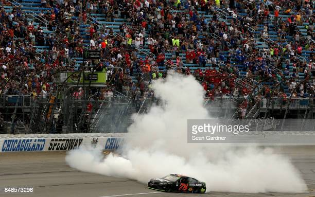 Martin Truex Jr driver of the Furniture Row/Denver Mattress Toyota celebrates with a burnout after winning the Monster Energy NASCAR Cup Series Tales...