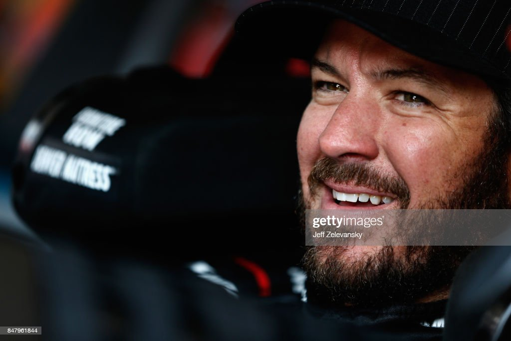 Martin Truex Jr., driver of the #78 Furniture Row/Denver Mattress Toyota, sits in his car during practice for the Monster Energy NASCAR Cup Series Tales of the Turtles 400 at Chicagoland Speedway on September 16, 2017 in Joliet, Illinois.