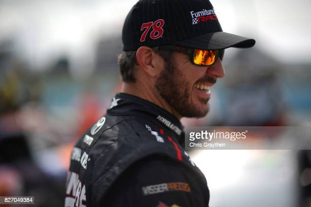 Martin Truex Jr driver of the Furniture Row/Denver Mattress Toyota stands on the grid prior to the Monster Energy NASCAR Cup Series I Love NY 355 at...