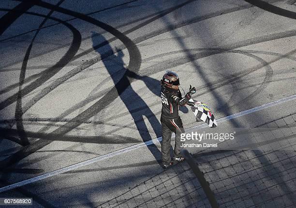 Martin Truex Jr driver of the Furniture Row/Denver Mattress Toyota celebrates after winning the NASCAR Sprint Cup Series Teenage Mutant Ninja Turtles...