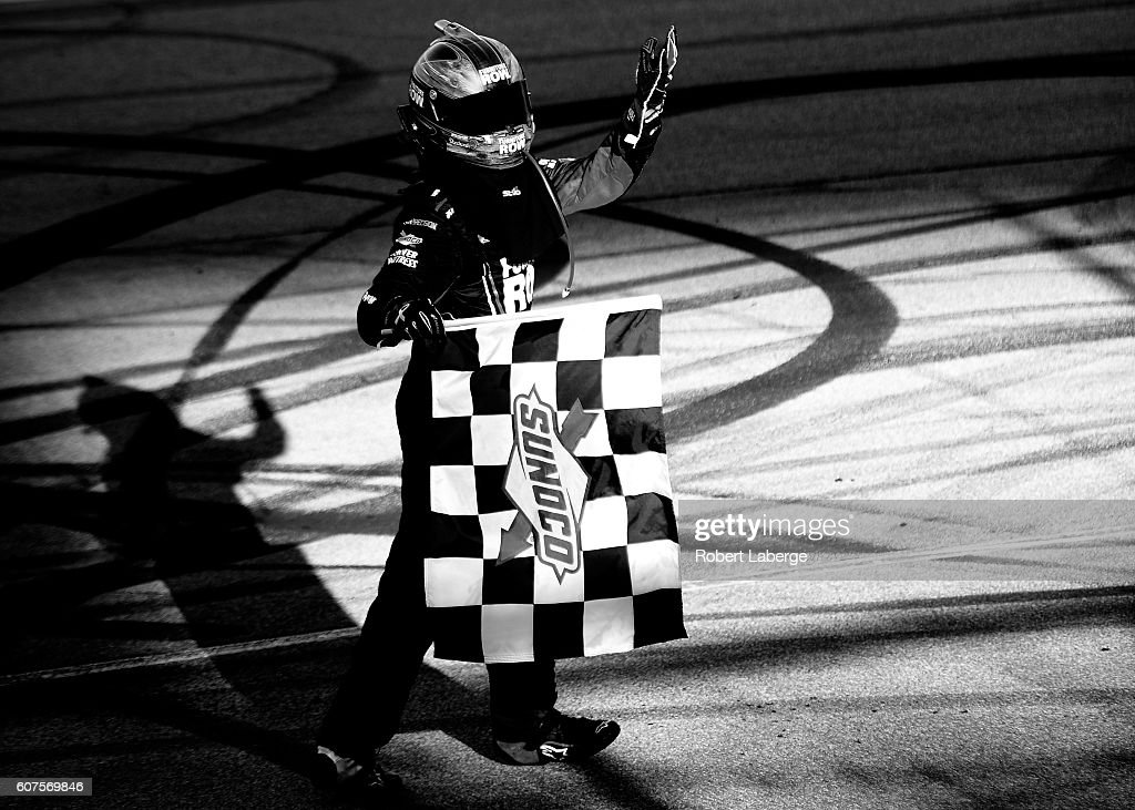 Martin Truex Jr, driver of the #78 Furniture Row/Denver Mattress Toyota, celebrates after winning the NASCAR Sprint Cup Series Teenage Mutant Ninja Turtles 400 at Chicagoland Speedway on September 18, 2016 in Joliet, Illinois.