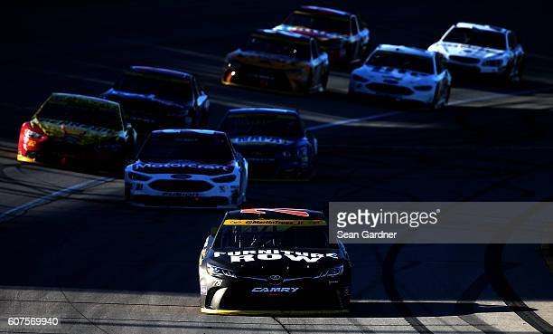 Martin Truex Jr driver of the Furniture Row/Denver Mattress Toyota leads the field on the last lap during the NASCAR Sprint Cup Series Teenage Mutant...