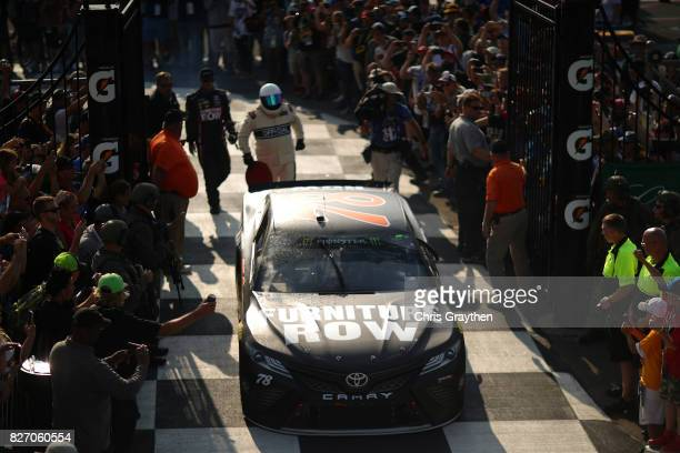 Martin Truex Jr driver of the Furniture Row/Denver Mattress Toyota drives into victory lane after winning the Monster Energy NASCAR Cup Series I Love...