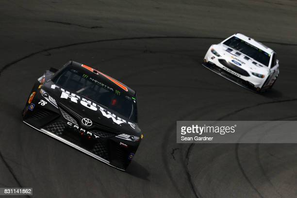 Martin Truex Jr driver of the Furniture Row/Denver Mattress Toyota leads Brad Keselowski driver of the Miller Lite Ford during the Monster Energy...