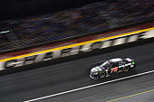 Martin Truex Jr driver of the Furniture Row/Visser Precision Chevrolet leads the field during the NASCAR Sprint Cup Series CocaCola 600 at Charlotte...