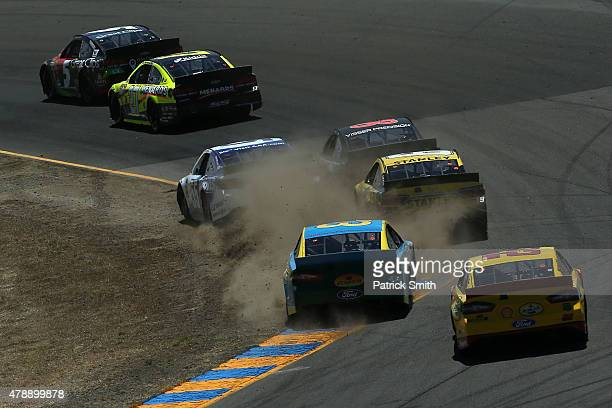 Martin Truex Jr driver of the Furniture Row/Visser Precision Chevrolet crashes into the wall during the NASCAR Sprint Cup Series Toyota/Save Mart 350...