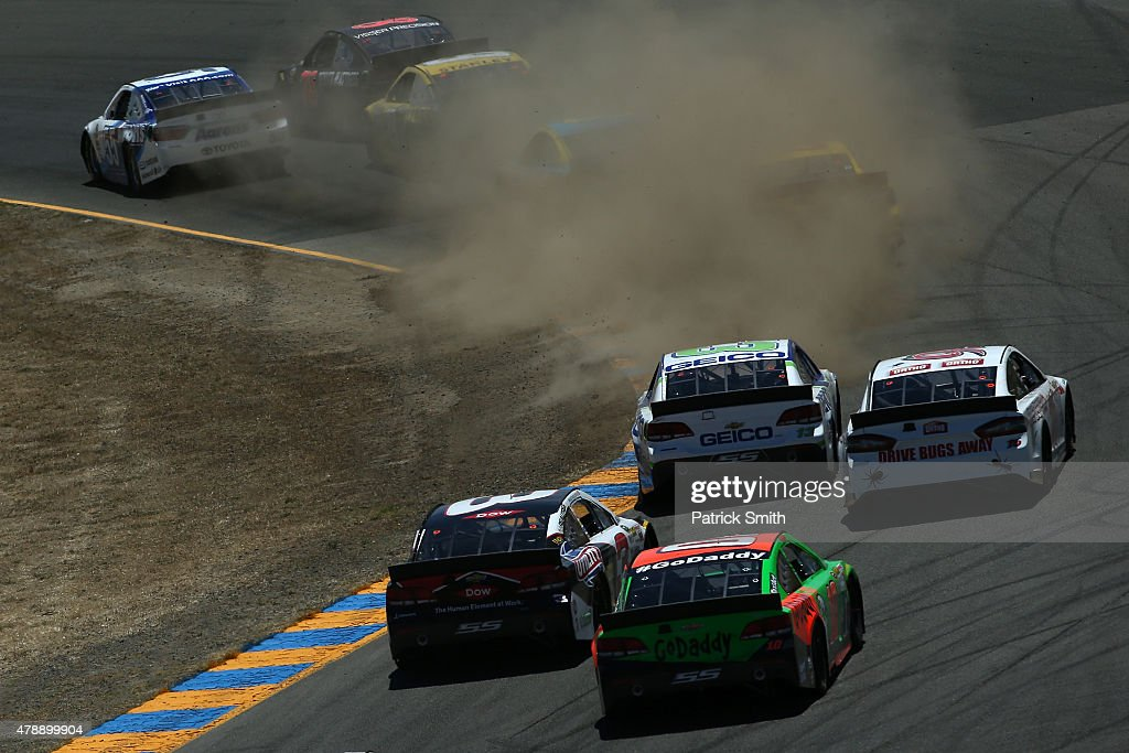 <a gi-track='captionPersonalityLinkClicked' href=/galleries/search?phrase=Martin+Truex+Jr.&family=editorial&specificpeople=184514 ng-click='$event.stopPropagation()'>Martin Truex Jr.</a>, driver of the #78 Furniture Row/Visser Precision Chevrolet, is pushed off the track by <a gi-track='captionPersonalityLinkClicked' href=/galleries/search?phrase=David+Ragan&family=editorial&specificpeople=574874 ng-click='$event.stopPropagation()'>David Ragan</a>, driver of the #55 Aaron's Dream Machine Toyota, during the NASCAR Sprint Cup Series Toyota/Save Mart 350 at Sonoma Raceway on June 28, 2015 in Sonoma, California.