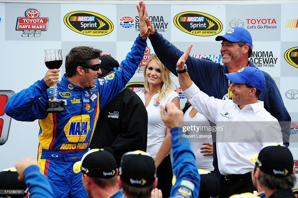 Martin Truex Jr., driver of the #56 NAPA Auto Parts Toyota, celebrates in Victory Lane with team owners Michael Waltrip and Rob Kauffman after winning the NASCAR Sprint Cup Series Toyota/Save Mart 350 at Sonoma Raceway on June 23, 2013 in Sonoma, California.