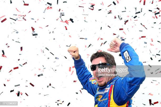 Martin Truex Jr driver of the NAPA Auto Parts Toyota celebrates in victory lane after winning the NASCAR Sprint Cup Series Toyota/Save Mart 350 at...