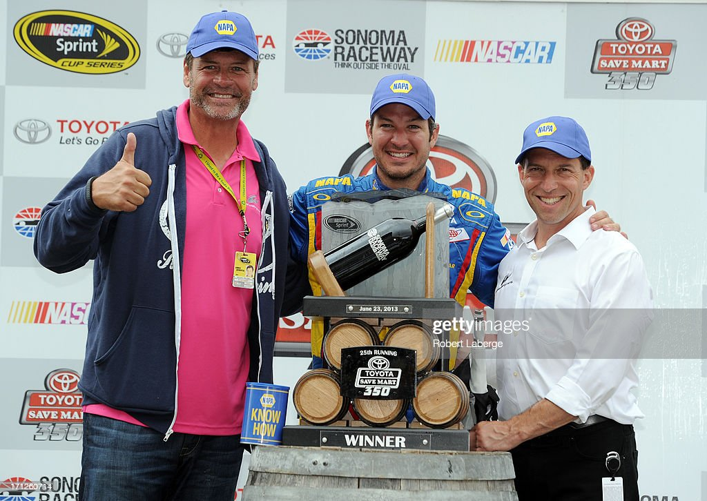 Martin Truex Jr.(C), driver of the #56 NAPA Auto Parts Toyota, celebrates in Victory Lane with team owners Michael Waltrip(L) and Rob Kauffman(R) after winning the NASCAR Sprint Cup Series Toyota/Save Mart 350 at Sonoma Raceway on June 23, 2013 in Sonoma, California.