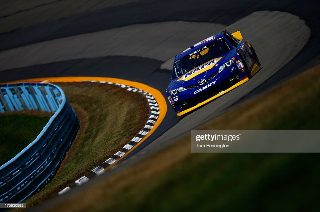 <a gi-track='captionPersonalityLinkClicked' href=/galleries/search?phrase=Martin+Truex+Jr.&family=editorial&specificpeople=184514 ng-click='$event.stopPropagation()'>Martin Truex Jr.</a>, driver of the #56 NAPA Auto Parts Toyota, drives during qualifying for the NASCAR Sprint Cup Series Cheez-It 355 at The Glen at Watkins Glen International on August 10, 2013 in Watkins Glen, New York.