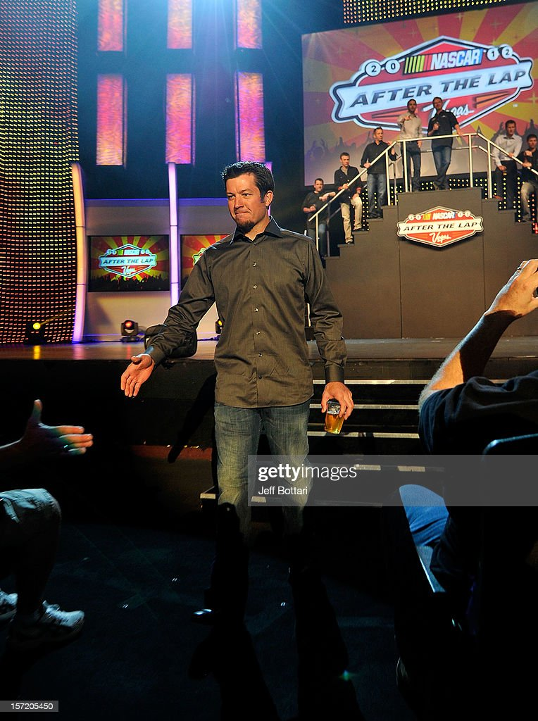 Martin Truex Jr., driver of the #56 NAPA Auto Parts Toyota, high-fives fans during NASCAR After The Lap at PH Live at Planet Hollywood Resort & Casino on November 29, 2012 in Las Vegas, Nevada.