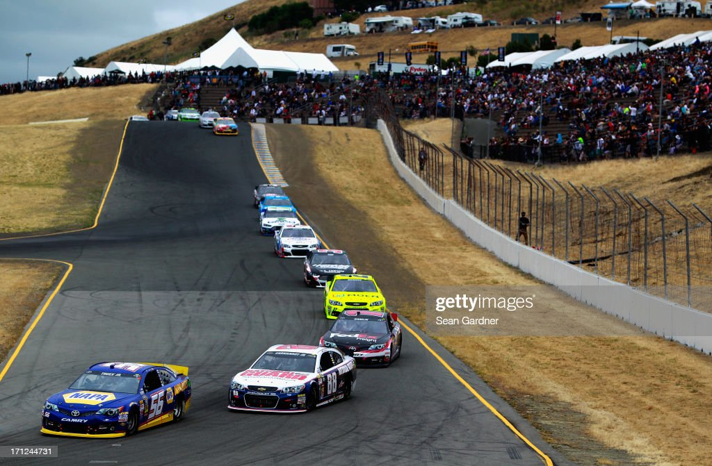 Martin Truex Jr., driver of the #56 NAPA Auto Parts Toyota, leads a pack of cars during the NASCAR Sprint Cup Series Toyota/Save Mart 350 at Sonoma Raceway on June 23, 2013 in Sonoma, California.