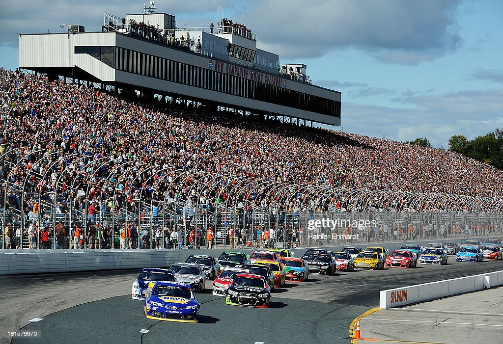 Martin Truex Jr., driver of the #56 NAPA Auto Parts Toyota, leads a pack of cars during the NASCAR Sprint Cup Series Sylvania 300 at New Hampshire Motor Speedway on September 22, 2013 in Loudon, New Hampshire.