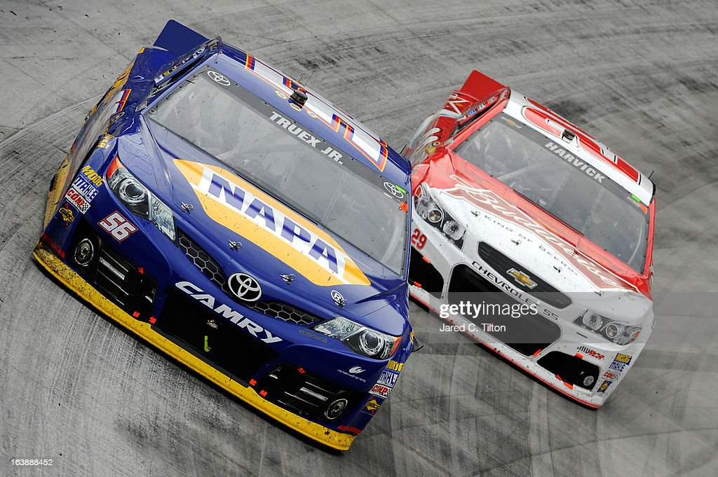 Martin Truex Jr., driver of the #56 NAPA Auto Parts Toyota, leads Kevin Harvick, driver of the #29 Budweiser Chevrolet, during the NASCAR Sprint Cup Series Food City 500 at Bristol Motor Speedway on March 17, 2013 in Bristol, Tennessee.