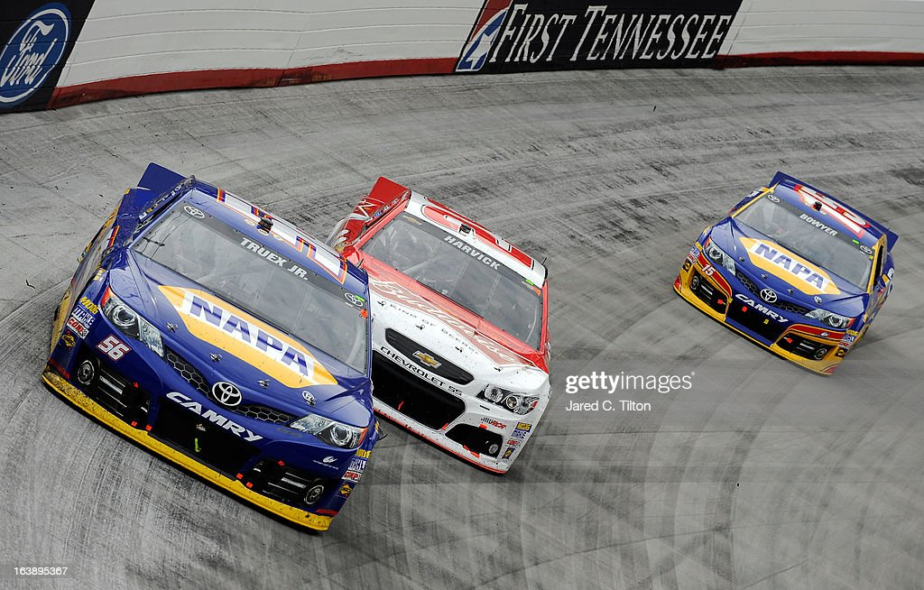 Martin Truex Jr., driver of the #56 NAPA Auto Parts Toyota, leads Kevin Harvick, driver of the #29 Budweiser Chevrolet, and Clint Bowyer, driver of the #15 NAPA Filters Toyota, during the NASCAR Sprint Cup Series Food City 500 at Bristol Motor Speedway on March 17, 2013 in Bristol, Tennessee.