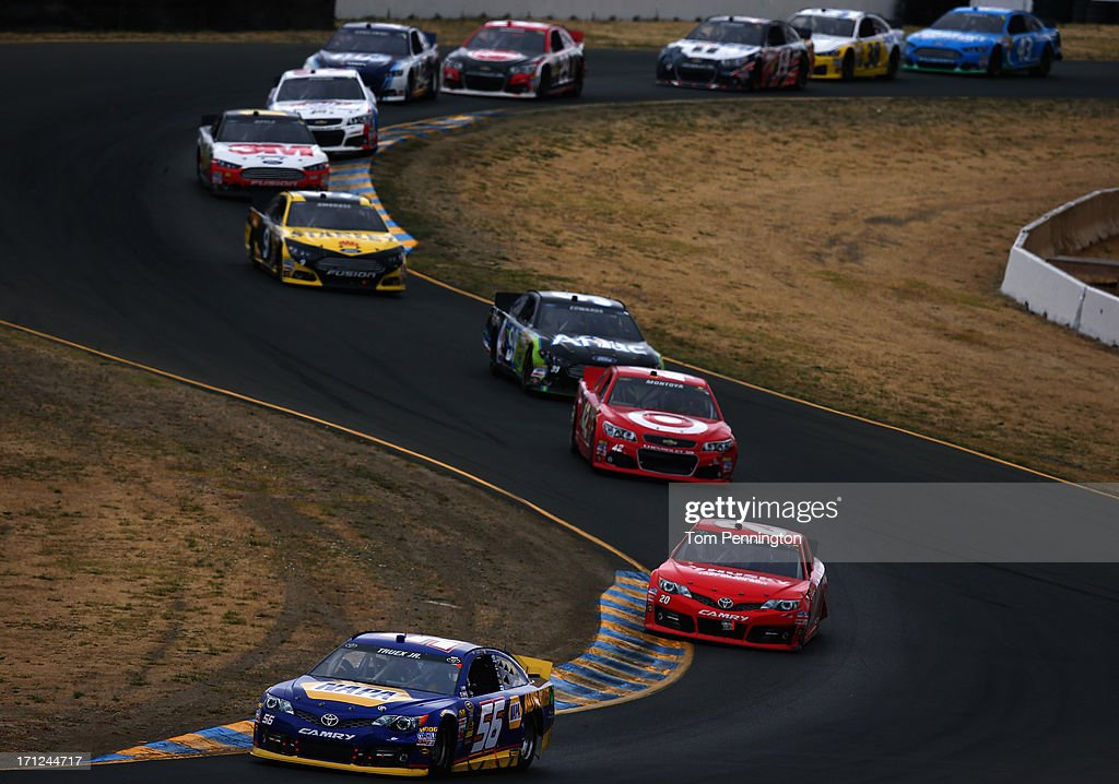 Martin Truex Jr., driver of the #56 NAPA Auto Parts Toyota, leads Matt Kenseth, driver of the #20 The Home Depot-Husky Toyota, during the NASCAR Sprint Cup Series Toyota/Save Mart 350 at Sonoma Raceway on June 23, 2013 in Sonoma, California.