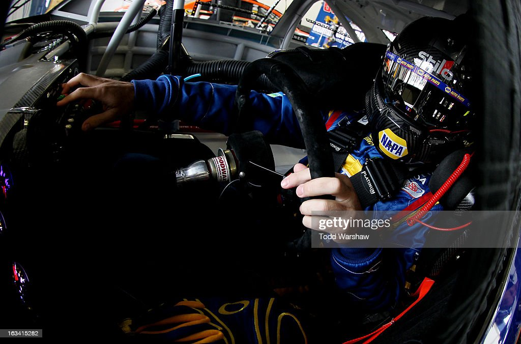 Martin Truex Jr., driver of the #56 NAPA Auto Parts Toyota, sits in his car in the garage area during practice for the NASCAR Sprint Cup Series Kobalt Tools 400 at Las Vegas Motor Speedway on March 9, 2013 in Las Vegas, Nevada.