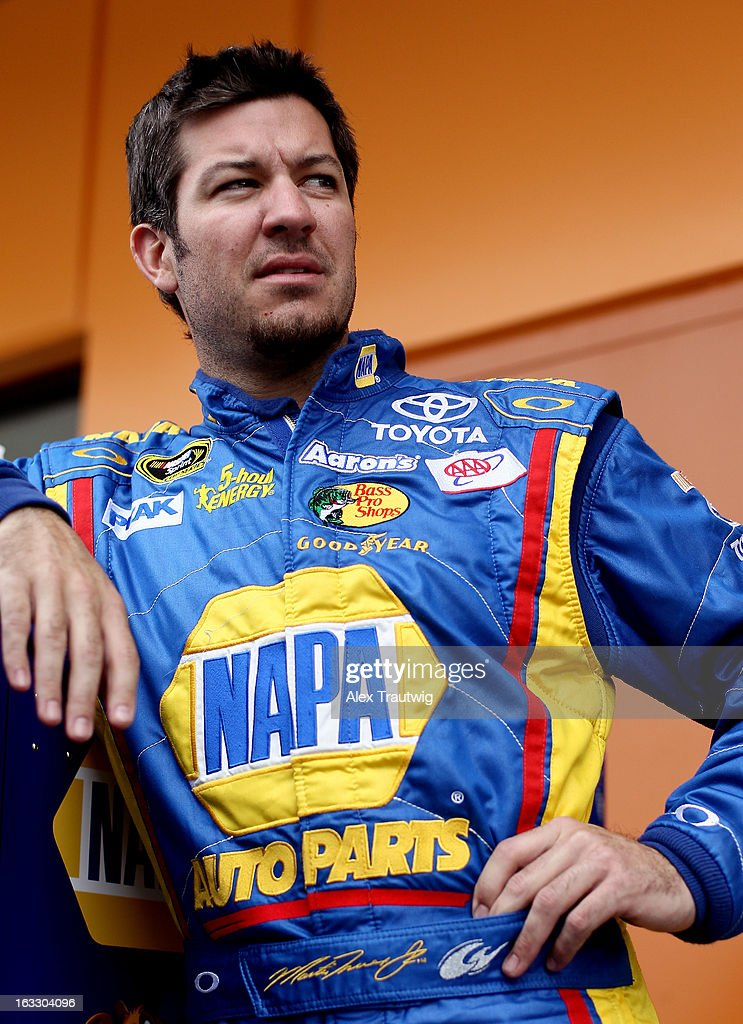 <a gi-track='captionPersonalityLinkClicked' href=/galleries/search?phrase=Martin+Truex+Jr.&family=editorial&specificpeople=184514 ng-click='$event.stopPropagation()'>Martin Truex Jr.</a>, driver of the #56 NAPA Auto Parts Toyota, stands in the garage area during NASCAR Sprint Cup Series testing at Las Vegas Motor Speedway on March 7, 2013 in Las Vegas, Nevada.
