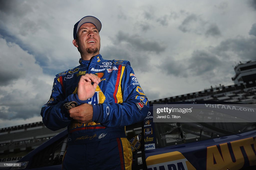 <a gi-track='captionPersonalityLinkClicked' href=/galleries/search?phrase=Martin+Truex+Jr.&family=editorial&specificpeople=184514 ng-click='$event.stopPropagation()'>Martin Truex Jr.</a>, driver of the #56 NAPA Auto Parts Toyota, stands on the grid during qualifying for the NASCAR Sprint Cup Series GoBowling.com 400 at Pocono Raceway on August 2, 2013 in Long Pond, Pennsylvania.