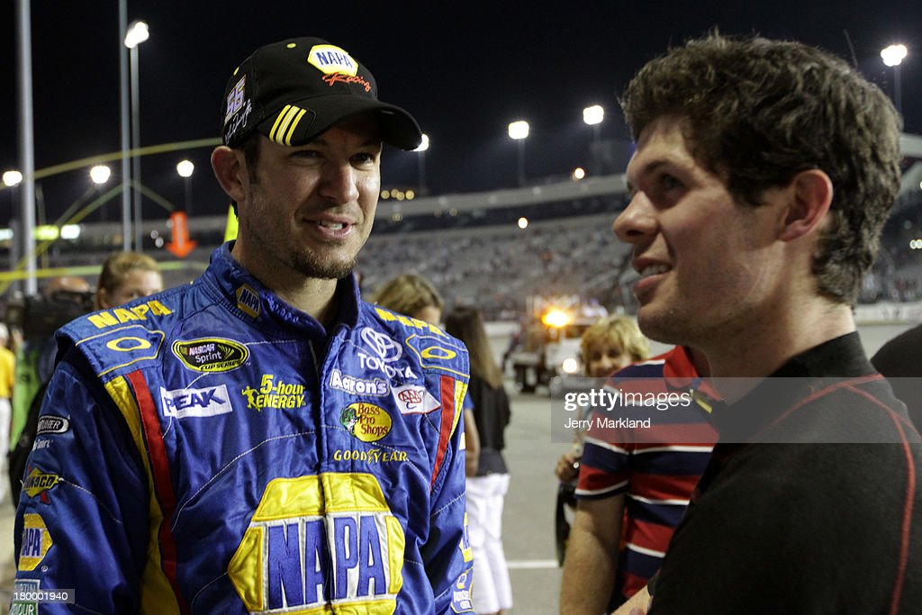 Martin Truex Jr., driver of the #56 NAPA Auto Parts Toyota, talks with brother Ryan Truex, driver of the #51 Seawatch Chevrolet, after the NASCAR Sprint Cup Series 56th Annual Federated Auto Parts 400 at Richmond International Raceway on September 7, 2013 in Richmond, Virginia.