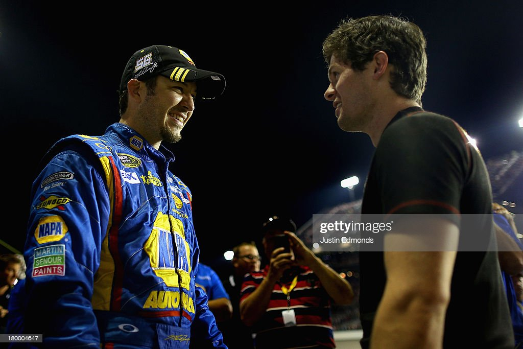 Martin Truex Jr., driver of the #56 NAPA Auto Parts Toyota, talks with brother Ryan Truex, driver of the #51 Seawatch Chevrolet, after Martin qualifying for the Chase for the Sprint Cup during the NASCAR Sprint Cup Series 56th Annual Federated Auto Parts 400 at Richmond International Raceway on September 7, 2013 in Richmond, Virginia.