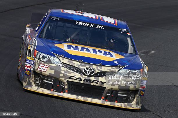 Martin Truex Jr driver of the NAPA Batteries Toyota during the NASCAR Sprint Cup Series Camping World RV Sales 301 at New Hampshire Motor Speedway on...