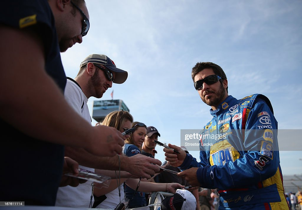 <a gi-track='captionPersonalityLinkClicked' href=/galleries/search?phrase=Martin+Truex+Jr.&family=editorial&specificpeople=184514 ng-click='$event.stopPropagation()'>Martin Truex Jr.</a>, driver of the #56 NAPA Brakes Toyota, signs autographs for fans during qualifying for the NASCAR Sprint Cup Series Toyota Owners 400 at Richmond International Raceway on April 26, 2013 in Richmond, Virginia.