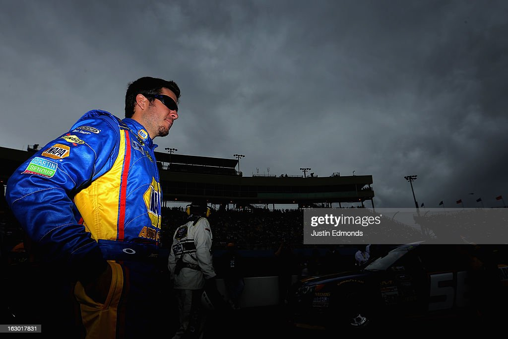 Martin Truex Jr., driver of the #56 NAPA Filters Toyota, looks on from pit road before the NASCAR Sprint Cup Series Subway Fresh Fit 500 at Phoenix International Raceway on March 3, 2013 in Avondale, Arizona.