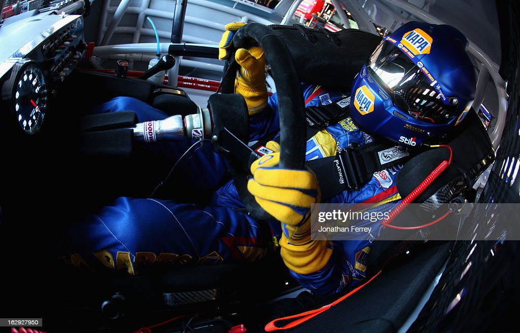 Martin Truex Jr., driver of the #56 NAPA Filters Toyota, sits in his car in the garage during practice for the NASCAR Sprint Cup Series Subway Fresh Fit 500 at Phoenix International Raceway on March 1, 2013 in Avondale, Arizona.