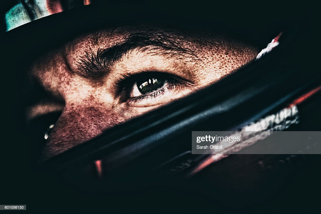 Martin Truex Jr., driver of the #78 Tanger Outlets Toyota, sits in his car during practice for the NASCAR Sprint Cup Series Federated Auto Parts 400 at Richmond International Raceway on September 9, 2016 in Richmond, Virginia.