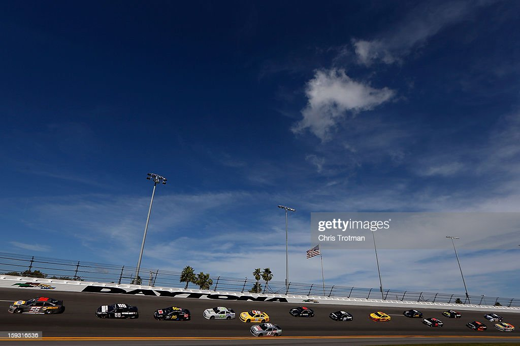 Martin Truex Jr. driver of the #56 Toyota leads a pack of cars during the NASCAR Sprint Cup Preseason Thunder testing at Daytona International Speedway on January 11, 2013 in Daytona Beach, Florida.