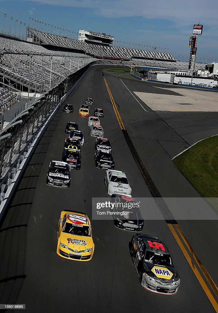 Martin Truex Jr., driver of the #56 Toyota, leads the field during the NASCAR Sprint Cup Preseason Thunder testing at Daytona International Speedway on January 11, 2013 in Daytona Beach, Florida.