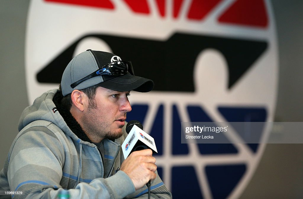 Martin Truex Jr., driver of the #56 Toyota, speaks to the media during NASCAR Testing at Charlotte Motor Speedway on January 18, 2013 in Charlotte, North Carolina.