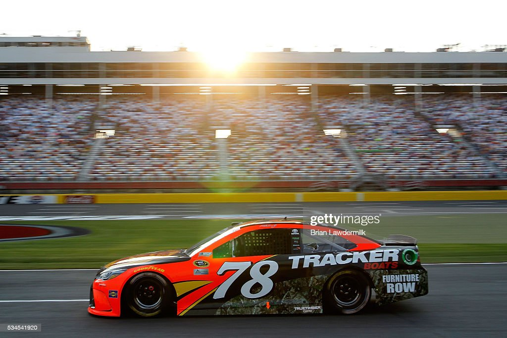 <a gi-track='captionPersonalityLinkClicked' href=/galleries/search?phrase=Martin+Truex+Jr.&family=editorial&specificpeople=184514 ng-click='$event.stopPropagation()'>Martin Truex Jr.</a> drives the #78 Bass Pro Shops/Tracker Toyota during qualifying for the NASCAR Sprint Cup Series Coca-Cola 600 at Charlotte Motor Speedway on May 27, 2016 in Charlotte, North Carolina.