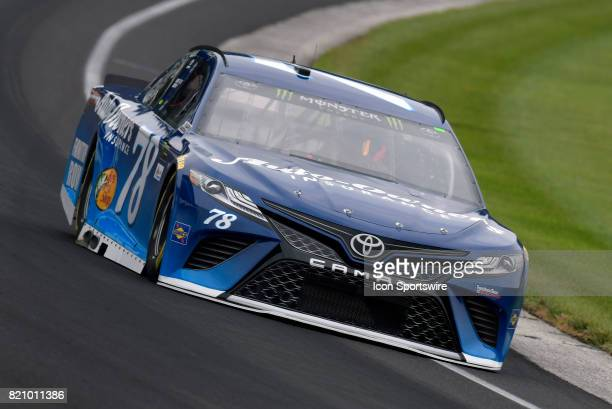 Martin Truex Jr Furniture Row Racing Toyota Camry drives through turn one during practice for the NASCAR Monster Energy Cup Series Brantley Gilbert...