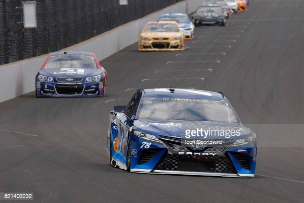Martin Truex Jr Furniture Row Racing Toyota Camry heads into turn one during the NASCAR Monster Energy Cup Series Brantley Gilbert Big Machine...