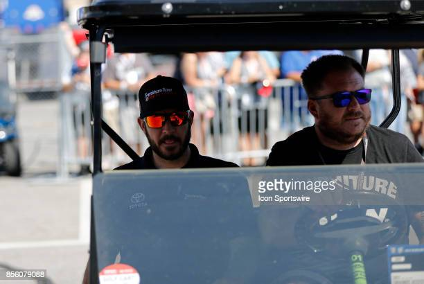 Martin Truex Jr Monster Energy NASCAR Cup Series driver of the Furniture Row / Denver Mattress Toyota arrives for the driver's meeting during the...