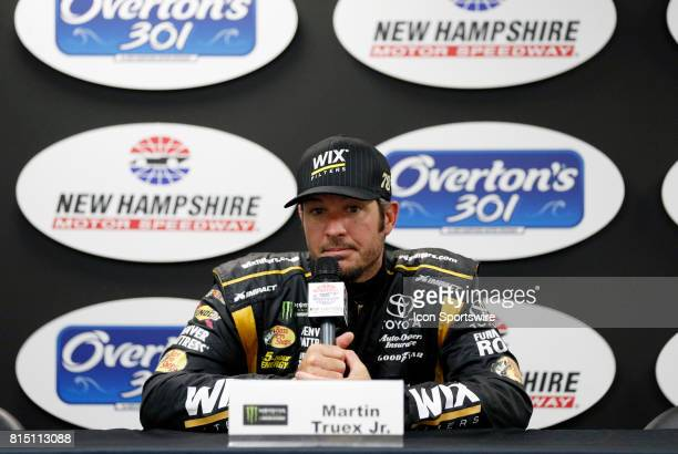 Martin Truex Jr Monster Energy NASCAR Cup Series driver of the WIX Filters Toyota ponders a question after qualifying for the Overton's 301 on July...