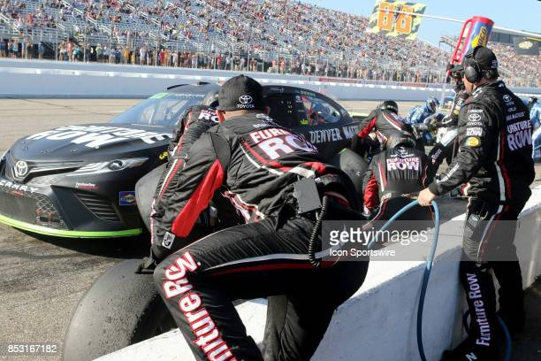 Martin Truex Jr's crew fixes accident damage during the Monster Energy NASCAR Cup Series ISM Connect 300 race on September 24 at New Hampshire Motor...
