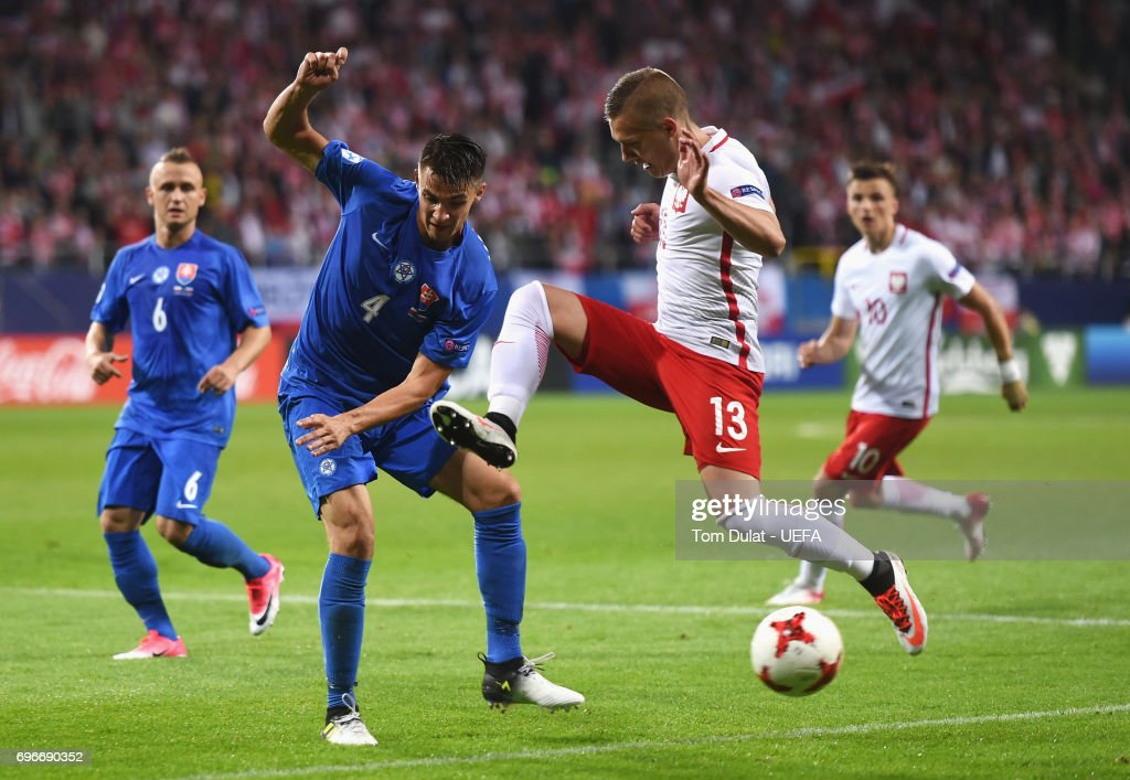 Martin Valjent of Slovakia challenges Lukasz Moneta of Poland during the UEFA European Under-21 Championship match between Poland and Slovakia at Lublin Stadium on June 16, 2017 in Lublin, Poland.