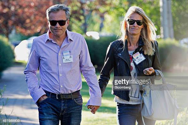 Martin Varsavsky chief executive officer of FON left walks with Nina Varsavsky while arriving for a morning session during the Allen Co Media and...