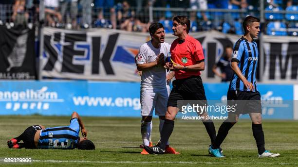 Martin Wagner of Meppen discuss with referee Guido Winkmann after the red card during the Third League playoff leg one match between Waldhof Mannheim...