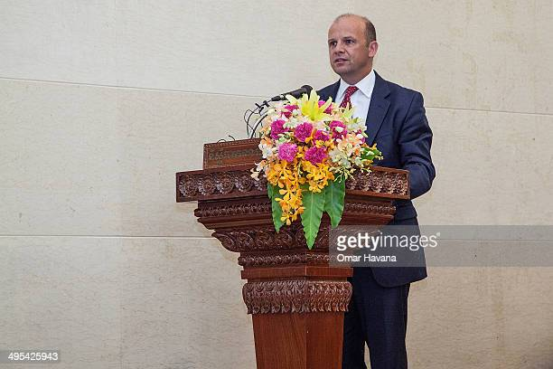 Martin Wilson Global CoHead of Legal and Risks for Christie's International gives a speech during a ceremony to handover three statues back to...