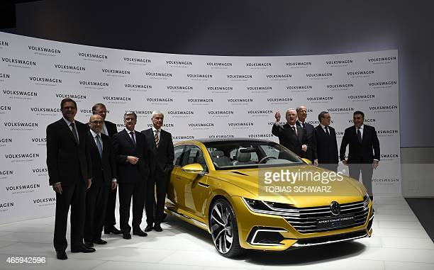 Martin Winterkorn chairman of German car maker Volkswagen and members of the board pose next to a VW Sport Coupe Concept GTE car prior to their...