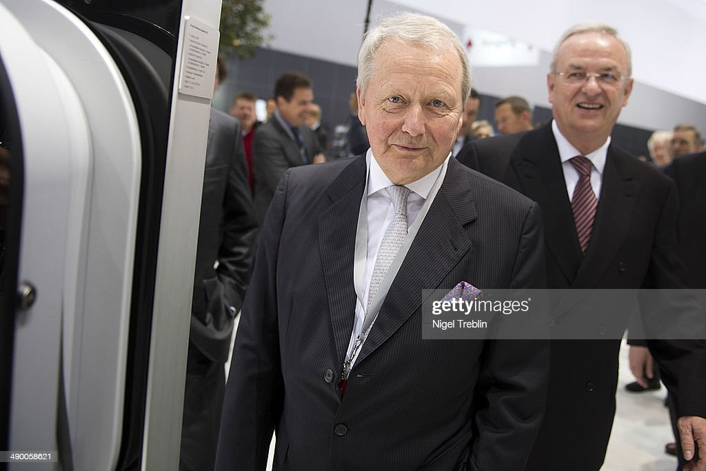 Martin Winterkorn (R), Chairman of German carmaker Volkswagen AG, and Wolfgang Porsche, chairman of Porsche AG, stand together ahead of Volkswagen annual shareholder meeting on May 13, 2014 in Hanover, Germany. Volkswagen presents the newest company results at the annual shareholder meeting.