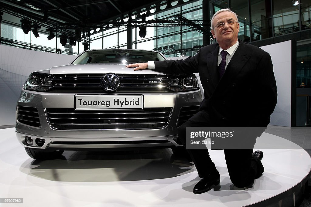<a gi-track='captionPersonalityLinkClicked' href=/galleries/search?phrase=Martin+Winterkorn&family=editorial&specificpeople=840091 ng-click='$event.stopPropagation()'>Martin Winterkorn</a>, Chairman of German carmaker Volkswagen AG, poses next to a VW Touareg Hybrid SUV upon his arrival at VW's annual press conference on March 11, 2010 in Wolfsburg, Germany. Winterkorn admitted that VW had been affected by the worldwide financial crisis in 2009, though reported that many of VW's brands reported growth, especially in China.