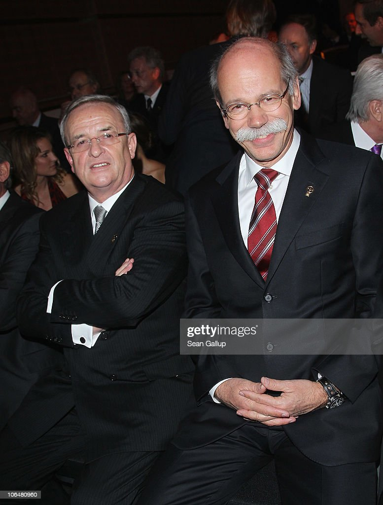 <a gi-track='captionPersonalityLinkClicked' href=/galleries/search?phrase=Martin+Winterkorn&family=editorial&specificpeople=840091 ng-click='$event.stopPropagation()'>Martin Winterkorn</a> (L), Chairman of Volkswagen AG, and <a gi-track='captionPersonalityLinkClicked' href=/galleries/search?phrase=Dieter+Zetsche&family=editorial&specificpeople=241297 ng-click='$event.stopPropagation()'>Dieter Zetsche</a>, Chairman of Daimler AG, attend the 2010 Das Goldene Lenkrad awards at Axel Springer Haus on November 3, 2010 in Berlin, Germany.