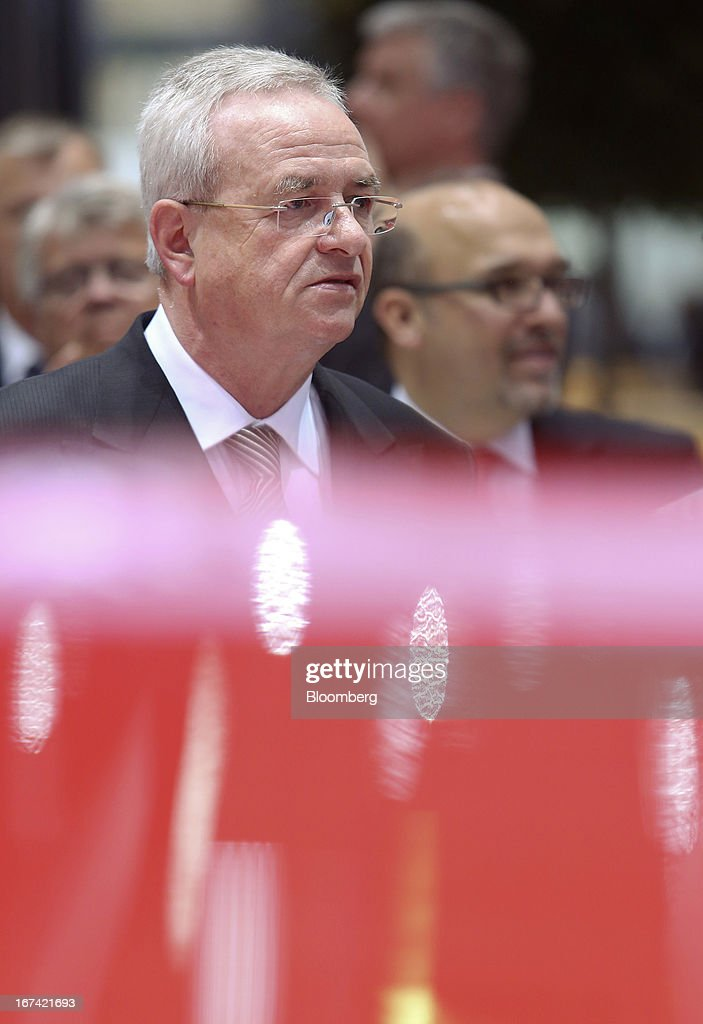 <a gi-track='captionPersonalityLinkClicked' href=/galleries/search?phrase=Martin+Winterkorn&family=editorial&specificpeople=840091 ng-click='$event.stopPropagation()'>Martin Winterkorn</a>, chief executive officer of Volkswagen AG, looks at a display of automobiles at the company's annual general meeting (AGM) in Hanover, Germany, on Thursday, April 25, 2013. Volkswagen AG, Europe's biggest automaker, aims to offset plunging European demand this year by rolling out 60 new and updated models, including luxury cruisers like the Bentley Flying Spur. Photographer: Chris Ratcliffe/Bloomberg via Getty Images